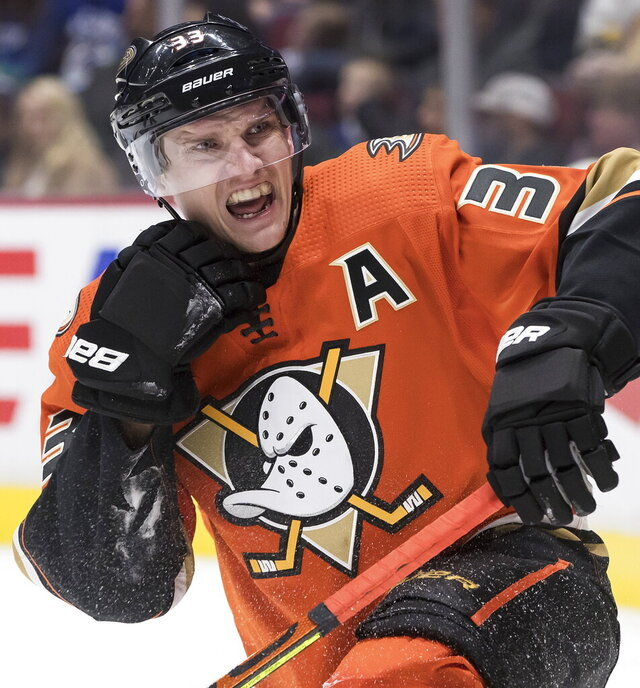 Anaheim Ducks' Jakob Silfverberg, of Sweden, looks to a referee for a penalty call against the Vancouver Canucks during the first period of an NHL hockey game Sunday, Feb. 16, 2020, in Vancouver, British Columbia. (Darryl Dyck/The Canadian Press via AP)