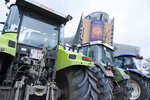 Tractors from Baltic farmers are parked outside of an EU summit in Brussels, Thursday, Feb. 20, 2020. Baltic farmers on Thursday were calling for a fair allocation of direct payments under the European Union's Common Agricultural Policy. (AP Photo/Riccardo Pareggiani)