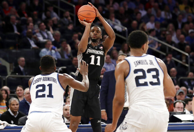 Providence's Alpha Diallo (11) shoots over Villanova's Dhamir Cosby-Roundtree (21) during the second half of an NCAA college basketball game in the Big East Conference tournament Thursday, March 14, 2019, in New York. Villanova won 73-62. (AP Photo/Frank Franklin II)