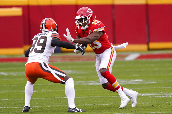 Kansas City Chiefs wide receiver Byron Pringle (13) runs from Cleveland Browns cornerback Terrance Mitchell, left, after catching a pass during the first half of an NFL divisional round football game, Sunday, Jan. 17, 2021, in Kansas City. (AP Photo/Charlie Riedel)