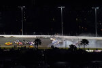 Racers crash during the last lap in the NASCAR Daytona 500 auto race at Daytona International Speedway, Monday, Feb. 15, 2021, in Daytona Beach, Fla. Michael McDowell, left, went on to win the race. Michael McDowell, left, went on to win the race. Among the other drivers are Joey Logano (22), Brad Keselowski (2) and Kyle Busch (18). (AP Photo/Chris O'Meara)