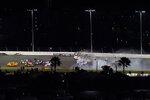 Racers crash during the last lap in the NASCAR Daytona 500 auto race at Daytona International Speedway, Monday, Feb. 15, 2021, in Daytona Beach, Fla. Michael McDowell, left, went on to win the race. Michael McDowell, left, went on to win the race. Among the other drivers are Joey Logano (22), Brad Keselowski (2) and Kyle Busch (18). (AP Photo/Chris O'Meara)