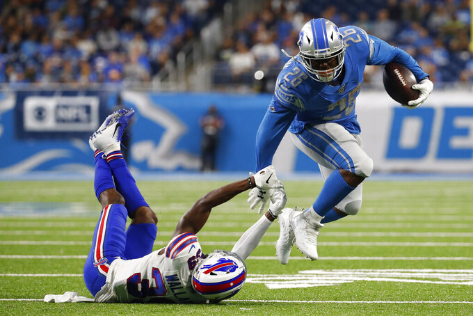 Detroit Lions running back C.J. Anderson (26) breaks the tackle of Buffalo Bills defensive back Levi Wallace (39) during the first half of an NFL preseason football game in Detroit, Friday, Aug. 23, 2019. (AP Photo/Rick Osentoski)