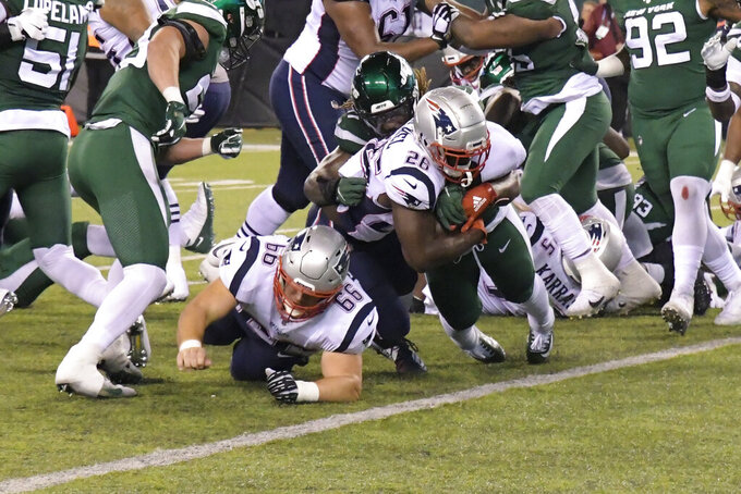 New England Patriots' Sony Michel (26) rushes for a touchdown during the first half of an NFL football game against the New York Jets, Monday, Oct. 21, 2019, in East Rutherford, N.J. (AP Photo/Bill Kostroun)