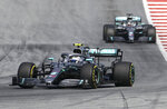 Mercedes driver Valtteri Bottas of Finland takes a curve followed by teammate Lewis Hamilton of Britain during the Austrian Formula One Grand Prix at the Red Bull Ring racetrack in Spielberg, southern Austria, Sunday, June 30, 2019. (AP Photo/Ronald Zak)
