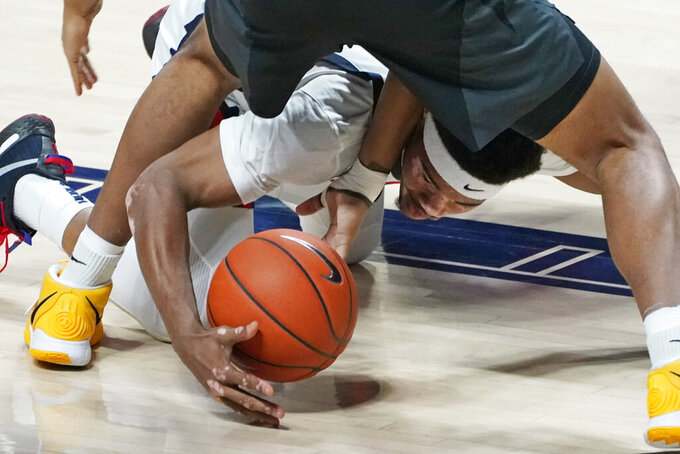 Mississippi guard Devontae Shuler reaches for the ball during the second half of the team's NCAA college basketball game against Missouri in Oxford, Miss., Wednesday, Feb. 10, 2021. (AP Photo/Rogelio V. Solis)