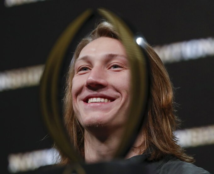 Clemson's Trevor Lawrence answers questions at a news conference for the NCAA college football playoff championship game Tuesday, Jan. 8, 2019, in San Jose, Calif. (AP Photo/David J. Phillip)