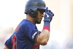 Minnesota Twins' Eddie Rosario celebrates his two-run home run off New York Yankees' pitcher J.A. Happ in the first inning of a baseball game Wednesday, July 24, 2019, in Minneapolis. (AP Photo/Jim Mone)