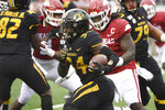FILE - In this Nov. 29, 2019, file photo, Missouri running back Larry Rountree III finds a hole in the Arkansas defense as he runs the ball during the first half of an NCAA college football game in Little Rock, Ark. Eli Drinkwitz already has experienced just about everything a college football coach could imagine in his first season. Except for playing a game. That will finally change on Sept. 26, 2020, when the Tigers' new coach leads his team into the opener of its SEC-only schedule against mighty Alabama. (AP Photo/Michael Woods, File)
