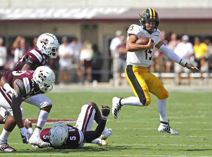 Southern Mississippi quarterback Jack Abraham (15) scrambles away from several Mississippi state defenders in the first half of an NCAA college football game Saturday, Sept. 7, 2019, in Starkville, Miss. (AP Photo/Jim Lytle)