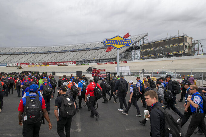 NASCAR Cup teams walking to the garage area before the Drydene 400 - Monster Energy NASCAR Cup Series playoff auto race, Sunday, Oct. 6, 2019, at Dover International Speedway in Dover, Del. (AP Photo/Jason Minto)
