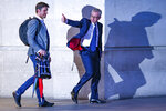 British Conservative party leadership contender Michael Gove, right, leaves BBC House after a TV debate in central London Tuesday, June 18, 2019. (AP Photo/Vudi Xhymshiti)