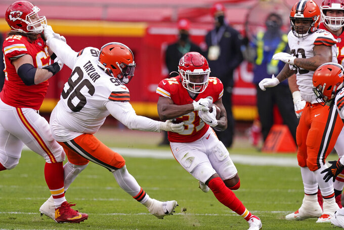 Kansas City Chiefs running back Darrel Williams (31) runs from Cleveland Browns defensive tackle Vincent Taylor (96) during the first half of an NFL divisional round football game, Sunday, Jan. 17, 2021, in Kansas City. (AP Photo/Charlie Riedel)