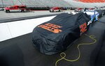 Dryers make their way around the track as cars sit covered before a NASCAR Cup Series auto race, Monday, April 16, 2018, in Bristol, Tenn. Kyle Larson leads with 296 laps left in the 500-lap race that started Sunday and was delayed due to weather. (AP Photo/Wade Payne)