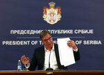 Serbia's President Aleksandar Vucic speaks during a press conference in Belgrade, Serbia, Tuesday, July 7, 2020. Serbia's president has announced the reintroduction of a curfew in Serbia after the highest single-day spike in deaths from the coronavirus. Vucic on Tuesday described the virus situation in Belgrade as