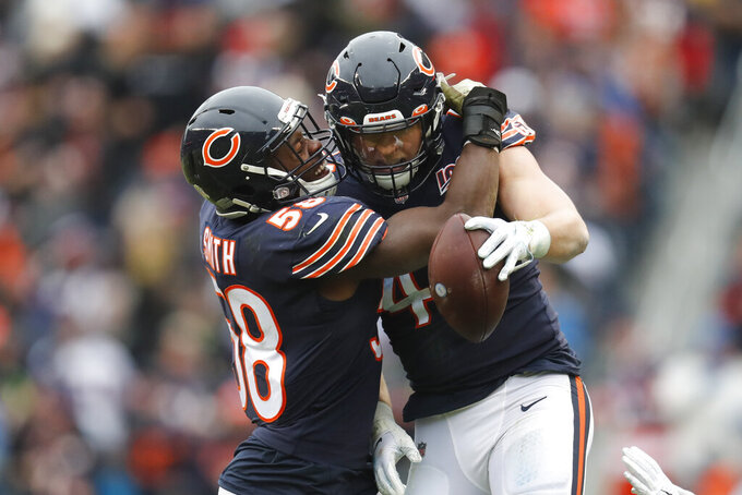 Chicago Bears inside linebacker Nick Kwiatkoski (44) celebrates his interception with Roquan Smith (58) during the second half of an NFL football game against the Detroit Lions in Chicago, Sunday, Nov. 10, 2019. (AP Photo/Charles Rex Arbogast)