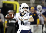 West Virginia quarterback Jack Allison looks for a receiver during the first half of the Camping World Bowl NCAA college football game against Syracuse, Friday, Dec. 28, 2018, in Orlando, Fla. (AP Photo/John Raoux)