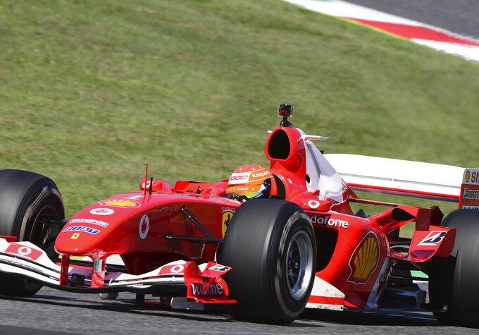 Mick Schumacher drives the Ferrari F2004 of his father Michael Schumacher during a display run before the Formula One Grand Prix of Tuscany, at the Mugello circuit in Scarperia, Italy, Sunday, Sept. 13, 2020. (Jennifer Lorenzini, Pool via AP)