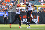 Cincinnati Bengals linebacker Darius Hodge (44) celebrates a sack with linebacker Germaine Pratt (57) in the second half of an NFL exhibition football game against the Miami Dolphins in Cincinnati, Sunday, Aug. 29, 2021. (AP Photo/Aaron Doster)