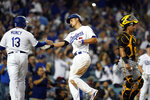 Los Angeles Dodgers' Corey Seager, center, celebrates his two-run home run with Max Muncy during the sixth inning of the team's baseball game against the Pittsburgh Pirates on Wednesday, Aug. 18, 2021, in Los Angeles. (AP Photo/Marcio Jose Sanchez)