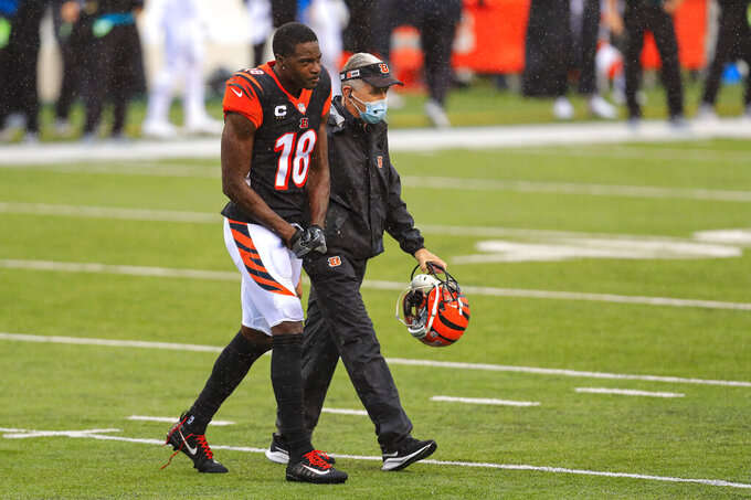 Cincinnati Bengals wide receiver A.J. Green (18) walks off the field after being injured in the second half of an NFL football game against the Jacksonville Jaguars in Cincinnati, Sunday, Oct. 4, 2020. (AP Photo/Aaron Doster)