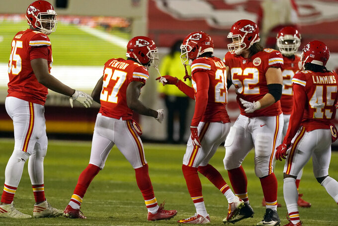 Kansas City Chiefs cornerback Rashad Fenton (27) celebrates with teammates after intercepting a pass during the second half of the AFC championship NFL football game against the Buffalo Bills, Sunday, Jan. 24, 2021, in Kansas City, Mo. (AP Photo/Charlie Riedel)