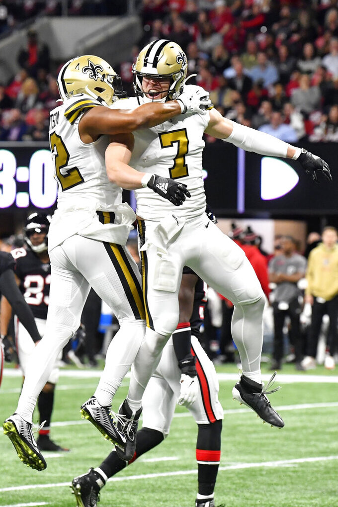 New Orleans Saints quarterback Taysom Hill (7) celebrates a Atlanta Falcons blocked punt during the first half of an NFL football game, Thursday, Nov. 28, 2019, in Atlanta. (AP Photo/John Amis)