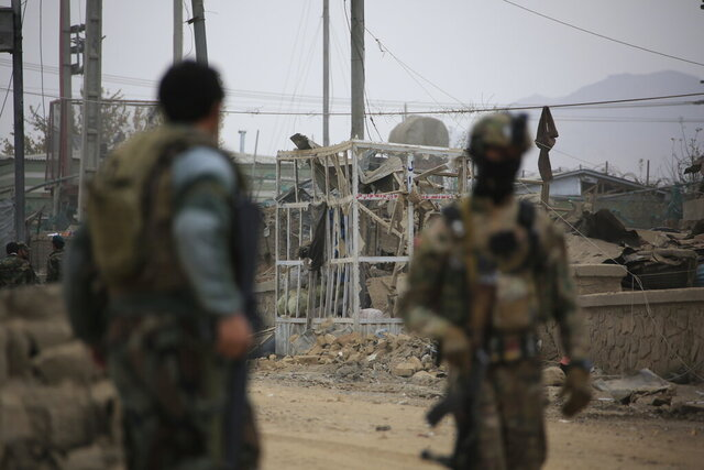 A damage form a blast is seen in Kabul, Afghanistan, Friday, Nov. 13, 2020. A suicide car bomb exploded at the western entry gate of Kabul killing and wounding several Afghan security troops. (AP Photo/Ahmad Seir Nassiri)