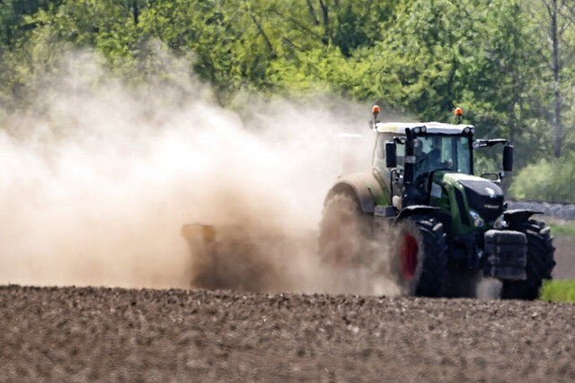 A tractor tills a field during a long time of drought near Bad Lauchstaedt, Germany, Monday, April 27, 2020. (AP Photo/Jens Meyer)