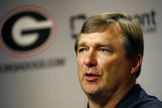 Georgia head coach Kirby Smart speaks to reporters before the team's first scheduled NCAA college football practice Friday, Aug. 2, 2019, in Athens, Ga. (AP Photo/John Bazemore)