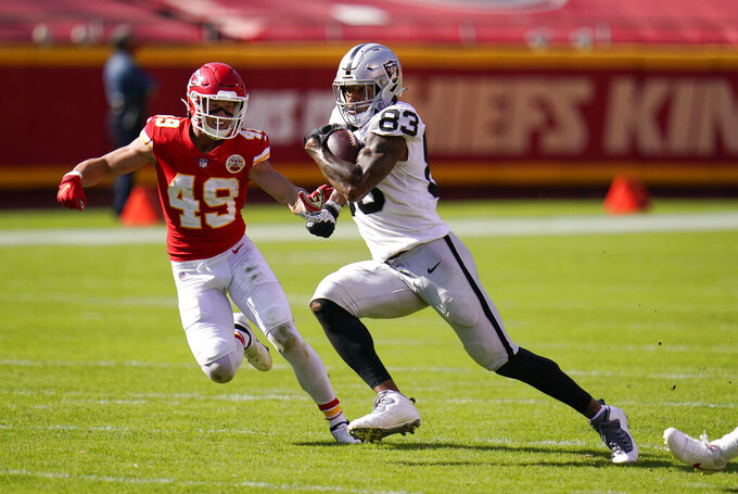 Las Vegas Raiders tight end Darren Waller (83) runs from Kansas City Chiefs safety Daniel Sorensen (49) after catching a pass during the second half of an NFL football game, Sunday, Oct. 11, 2020, in Kansas City. (AP Photo/Jeff Roberson)