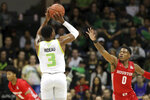 South Florida's Laquincy Rideau shoots over Houston's Marcus Sasser during the first half of an NCAA college basketball game Wednesday, Feb. 12, 2020, in Tampa, Fla. (AP Photo/Mike Carlson)