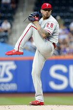 Philadelphia Phillies' Vince Velasquez winds up during the first inning of the team's baseball game against the New York Mets on Wednesday, July 11, 2018, in New York. (AP Photo/Frank Franklin II)
