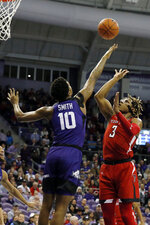 Texas Tech guard Jahmi'us Ramsey (3) floats the shot over TCU forward Diante Smith (10) during the first half of an NCAA college basketball game in Fort Worth, Texas, Tuesday, Jan. 21, 2020. (AP Photo/Ray Carlin)