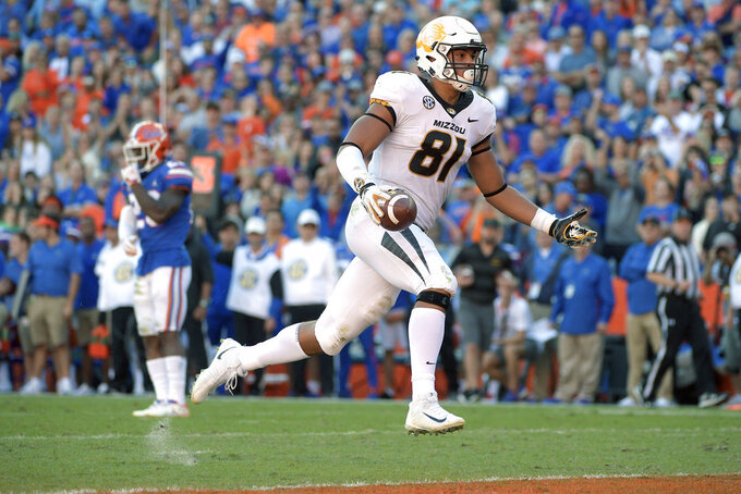 Missouri tight end Albert Okwuegbunam (81) hops over the goal line for a 22-yard receiving touchdown during the first half of an NCAA college football game against Florida, Saturday, Nov. 3, 2018, in Gainesville, Fla. (AP Photo/Phelan M. Ebenhack)