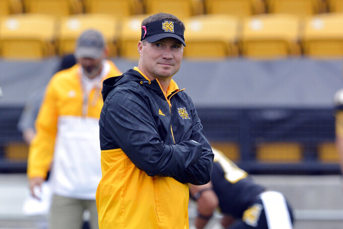 FILE - In this Oct. 10, 2015, file photo, Kennesaw State head coach Brian Bohannon watches before an NCAA college football game in Kennesaw, Ga. Bohannon is bringing Georgia Tech's old offense back to Bobby Dodd Stadium. Bohannon, the former Georgia Tech assistant now in his seventh season as FCS school Kennesaw State's first coach, is facing a difficult challenge in the Owls' first game against a Power 5 team on Saturday. (AP Photo/Lisa Marie Pane, File)