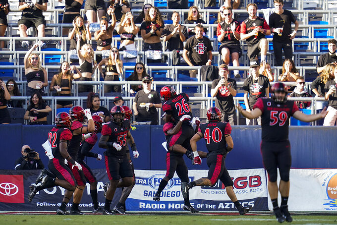 San Diego State players celebrate after San Diego State running back Jordan Byrd (15) scored a touchdown during the first half of an NCAA college football game against Utah Saturday, Sept. 18, 2021, in Carson, Calif. (AP Photo/Ashley Landis)