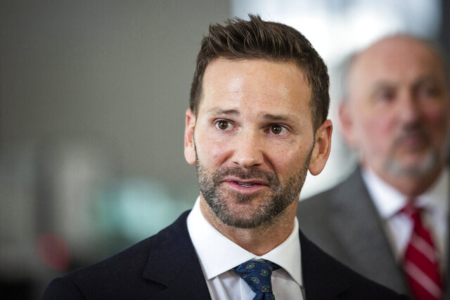 FILE - In this March 6, 2019 file photo, former U.S. Rep. Aaron Schock, R-Ill., speaks to reporters at the Dirksen Federal Courthouse in Chicago. On Thursday, March 5, 2020, Schock came out as gay in social media and web posts, saying he would do more if he were in Congress today to support LGBTQ rights _ which he opposed when he served. (Ashlee Rezin/Chicago Sun-Times via AP)