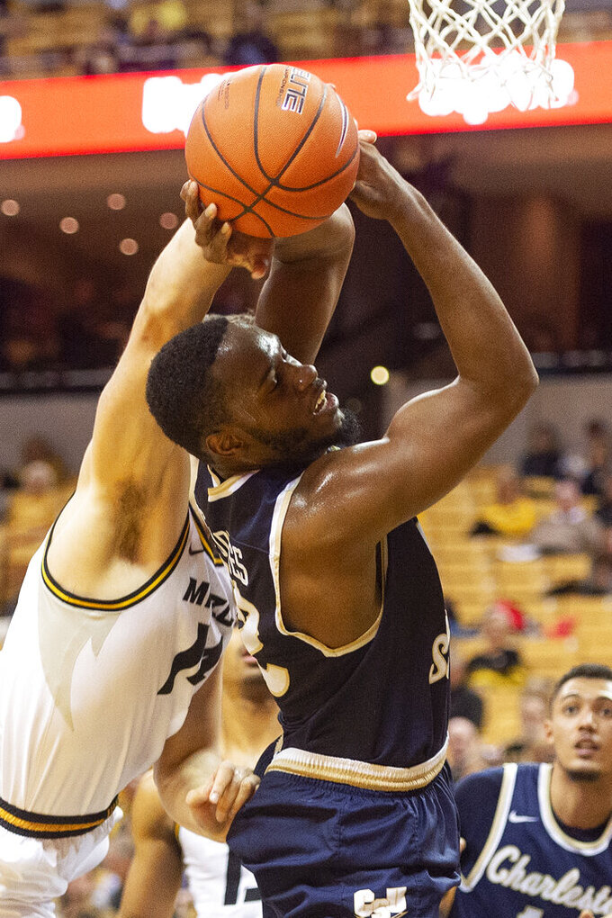 Missouri's Reed Nikko, left, blocks the shot of Charleston Southern's Ty Jones, right, during the first half of an NCAA college basketball game Tuesday, Dec. 3, 2019, in Columbia, Mo. (AP Photo/L.G. Patterson)