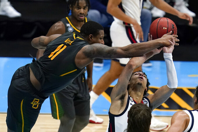 Gonzaga guard Andrew Nembhard is fouled by Baylor guard Mark Vital (11) during the second half of the championship game in the men's Final Four NCAA college basketball tournament, Monday, April 5, 2021, at Lucas Oil Stadium in Indianapolis. (AP Photo/Michael Conroy)
