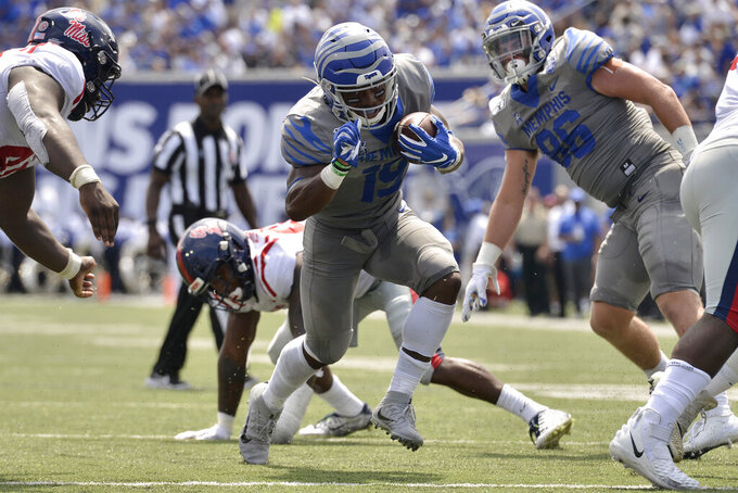 Memphis running back Kenneth Gainwell (19) carries the ball in the first half of an NCAA college football game against Mississippi, Saturday, Aug. 31, 2019, in Memphis, Tenn. (AP Photo/Brandon Dill)