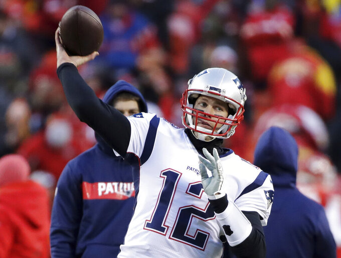 New England Patriots quarterback Tom Brady warms up before the AFC Championship NFL football game against the Kansas City Chiefs, Sunday, Jan. 20, 2019, in Kansas City, Mo. (AP Photo/Elise Amendola)
