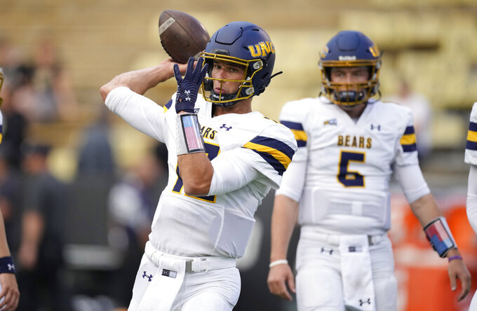 Northern Colorado quarterback Dylan McCaffrey warms up before an NCAA college football game against Colorado, Friday, Sept. 3, 2021, in Boulder, Colo. (AP Photo/David Zalubowski)