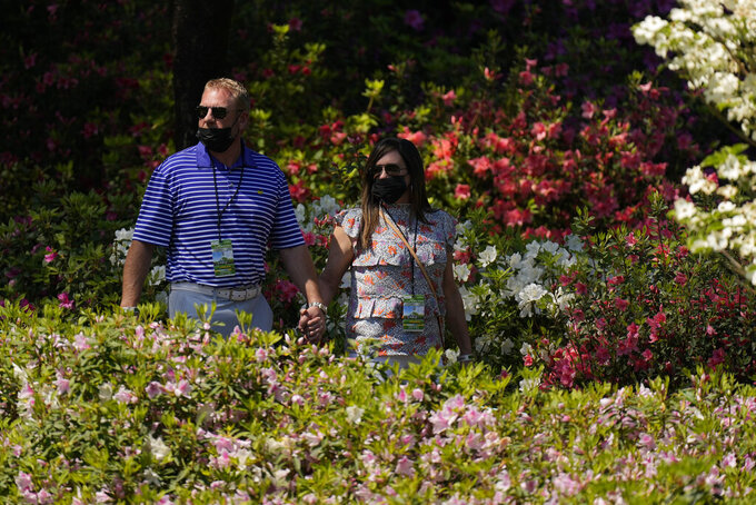 Patrons walk along the sixth hole during a practice round for the Masters golf tournament on Tuesday, April 6, 2021, in Augusta, Ga. (AP Photo/Matt Slocum)
