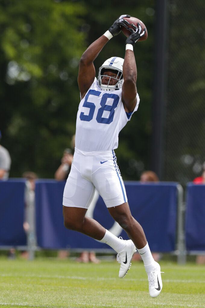 Indianapolis Colts linebacker Bobby Okereke (58) makes a catch as he runs a drill during practice at the NFL team's football training camp in Westfield, Ind., Friday, July 26, 2019. (AP Photo/Michael Conroy)