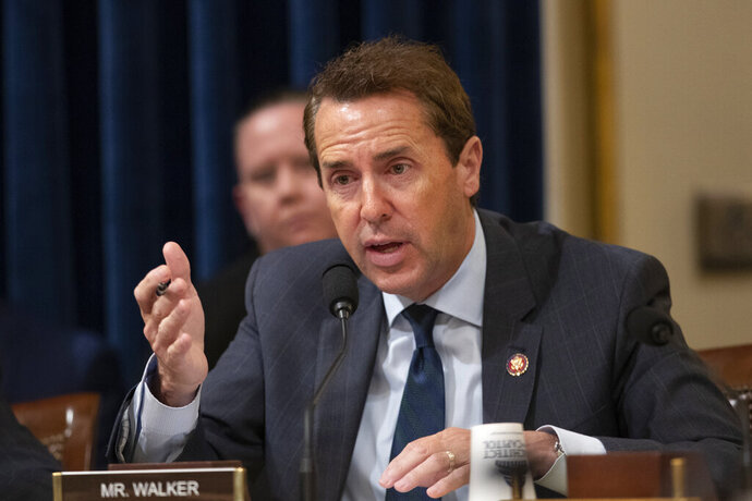 File-This Sept. 18, 2019, file photo shows House Committee on Homeland Security member Rep. Mark Walker, R-N.C. speaking during a hearing on Capitol Hill in Washington. After a North Carolina insurance magnate and mega-political donor was indicted on bribery charges in April, some politicians who received his campaign dollars offloaded his money by giving it to charity. But Republican party organizations tied to a GOP rising star in Congress show no signs of giving up nearly a quarter-million dollars from indicted businessman Greg Lindberg. A spokesman for Walker says the North Carolina congressman didn't control, and therefore couldn't give away, most of the over $238,000 that Lindberg gave his campaign and affiliated committees.(AP Photo/Manuel Balce Ceneta, File)