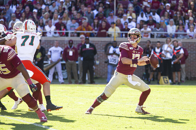 Florida State quarterback Alex Hornibrook (12) looks for a receiver in the first half of an NCAA college football game against Miami in Tallahassee, Fla., Saturday, Nov. 2, 2019. (AP Photo/Mark Wallheiser)
