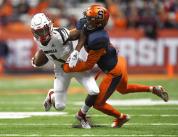 Louisville wide receiver Chatarius Atwell, left, is tackled by Syracuse defensive back Antwan Cordy during the first half of an NCAA college football game in Syracuse, N.Y., Friday, Nov. 9, 2018. (AP Photo/Adrian Kraus)