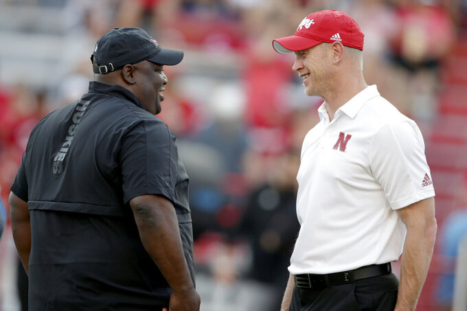 Nebraska head coach Scott Frost, right, chats with Northern Illinois head coach Thomas Hammock before playing an NCAA college football game in Lincoln, Neb., Saturday, Sept. 14, 2019. (AP Photo/Nati Harnik)
