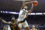 Purdue guard Nojel Eastern (20) grabs a rebound over Minnesota guard Marcus Carr (5) during the second half of an NCAA college basketball game in West Lafayette, Ind., Thursday, Jan. 2, 2020. Purdue won 83-78 in double overtime. (AP Photo/Michael Conroy)